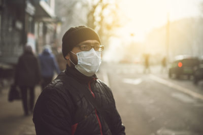 A man wearing a mask on the street. Protection against virus and